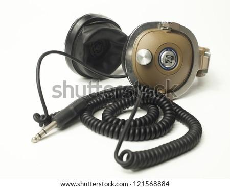 retro headphones shot against white