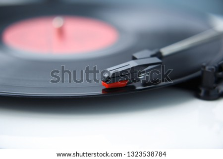 Retro hifi turntable player needle.Vintage audio equipment for music lovers.Enjoy high quality sound with analog audio equipment