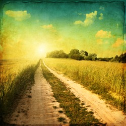 Retro image of country road at sunset.