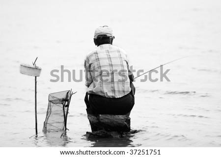 Retro image of fishermen - stock photo