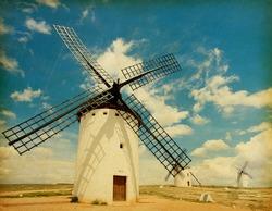Retro image  of Medieval Windmills.   Castilla La Mancha, Spain. Paper texture.