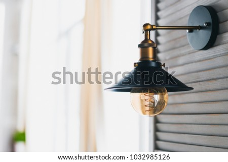 retro incandescent lamp in a modern loft style, wall lamp modern. horizontally