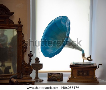 Retro interior items, gramophone, box, lamp, stand on the windowsill.