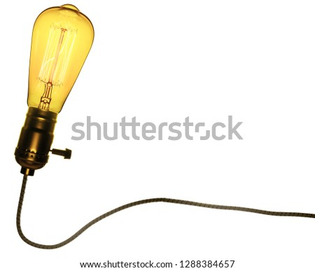 Retro lamp in retro base, with retro cable. Isolated on white background. Color image.