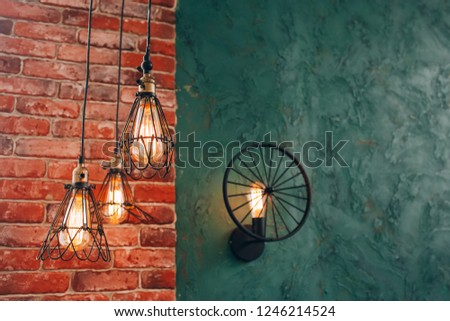 Retro lamp on a brick wall background. incandescent lamp. steel decorative lamp. modern lamp. steampunk