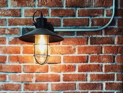 Retro lamp on the brick wall. Interior design in vintage style.