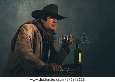 Shutterstock Retro late 1960s mexican western actor. Drinking whiskey at bar.