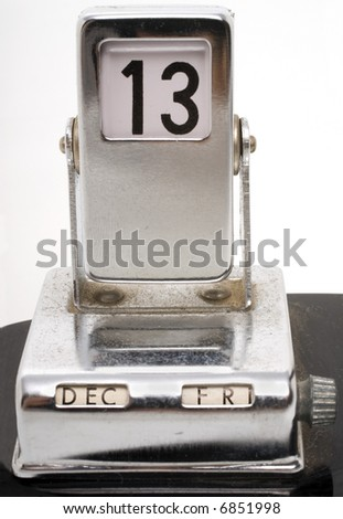 retro looking metallic desk calendar showing Friday 13th