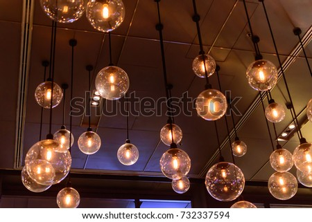 Retro luxury light lamp decor glowing.hanging incandescent lamp with glowing light bulb in dark room as decoration idea for interior and holiday and abstract background in hipster style.