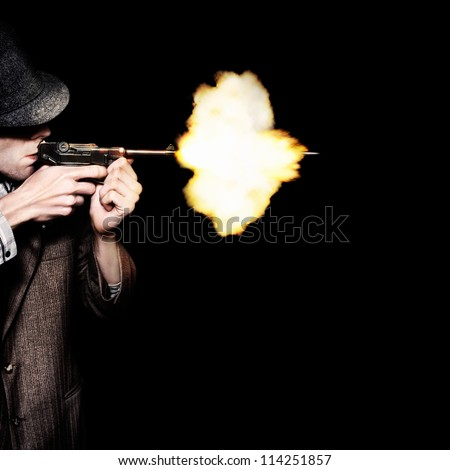 Retro Male Gangster Shooting Old Fashioned Pistol On Black Background - stock photo