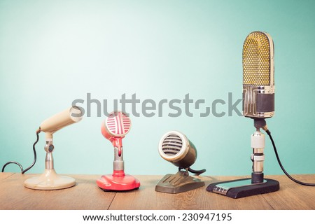 Retro mass media microphones for broadcasting or recording front mint green wall background #230947195
