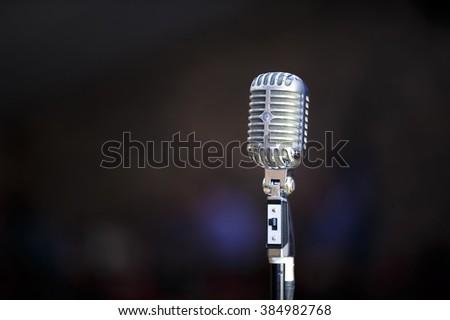 retro microphone against blur...