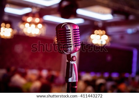 Retro microphone on stage in a pub or American Bar(restaurant) during a night show.  - Shutterstock ID 411443272