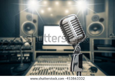 Retro microphone over the photo blurred of music studio band background with music instrument, musical concept