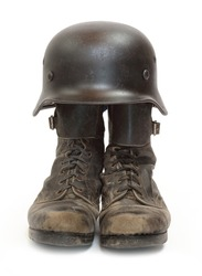 Retro military helmet and boots (biker's accessories) on a white background.