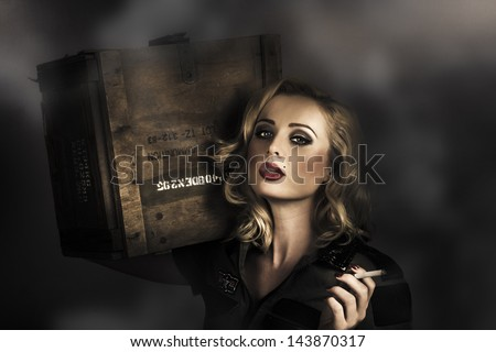 Retro military pinup girl in grunge army fashion holding ammo resupplies with smoking hot blond hairstyle and classic makeup. All's fair in love and war
