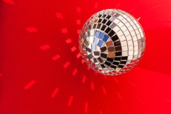 Retro mirror disco ball sun glare reflection copy space. Disco night life party dance 70s 80s concept. festive new year christmas xmas. abstract red minimal background, banner, frame, card