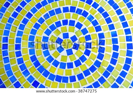 Retro Mosaic in a circular pattern of blue and yellow tiles.