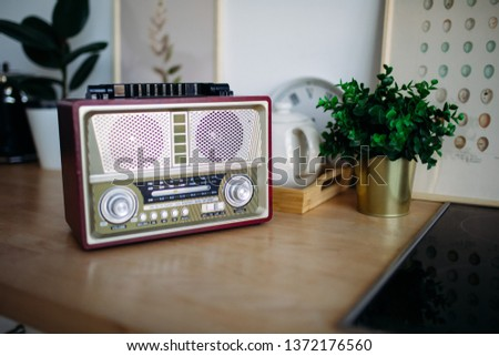 retro music. retro radio on the kitchen table #1372176560