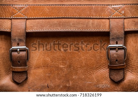 Retro old genuine leather textured background with closed vintage belt buckles - Shutterstock ID 718326199