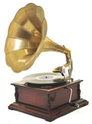 retro old gramophone with horn speaker  for playing music over plates  isolated on white in studio