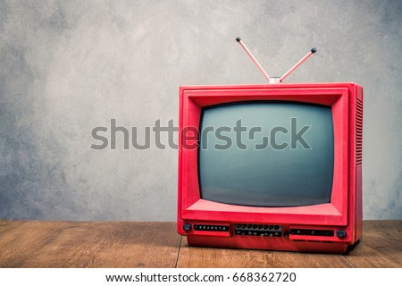 retro old  red tv receiver on...