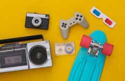 Retro old school attributes 80s on yellow background. Top view. Flat lay
