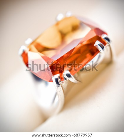 retro old silver ring with orange gem in box isolated on a white