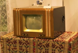 Retro old television from 70s on table. Vintage instagram style filtered photo