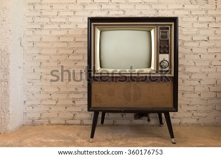 Retro old television in vintage white wall background #360176753