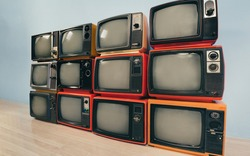 Retro old televisions pile in the room.