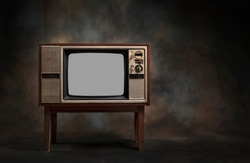 Retro old TV standing on a dark background