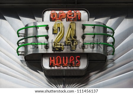 Retro Open 24 Hours neon illuminated sign