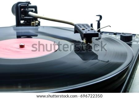 Retro party dj turntable to play music on vinyl audio disc.