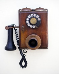 Retro phone on a white wall