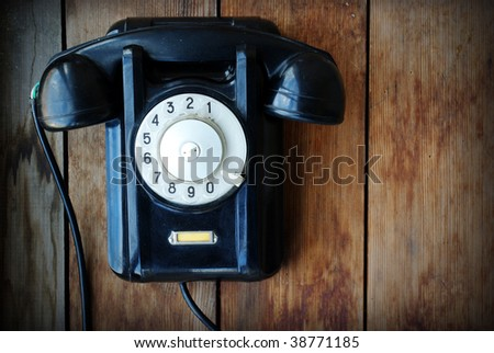 Retro phone on a wooden wall