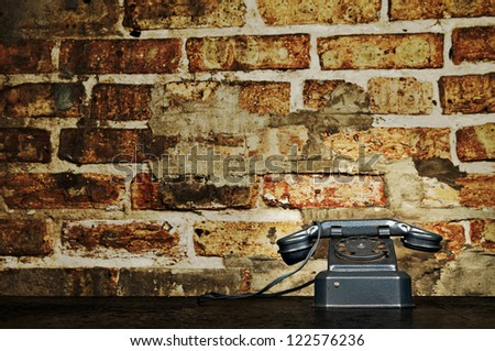 Retro Phone - Vintage Telephone on Old Desk with Brick Wall