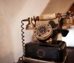 Retro Phone - vintage telephone on wooden table