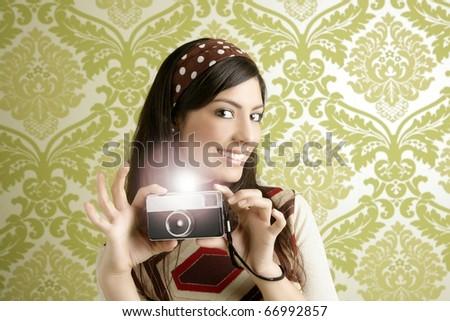 Retro photo camera shooting woman green sixties wallpaper vintage [Photo Illustration] - stock photo