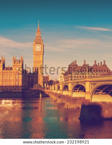 Retro Photo Filter Processed Effect - Elizabeth Tower, Big Ben and Westminster Bridge in early morning light, London, England, UK