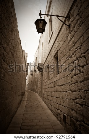 Retro photo of Old narrow town street of Mdina. Malta