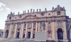 Retro photo of St. Peter Basilica front entrance with statues, Vatican Rome