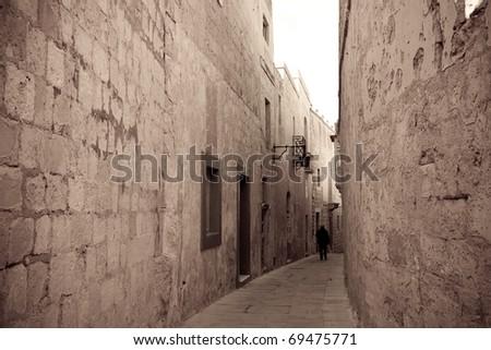 Retro photo of street in old mediterranean town (Mdina, Malta)