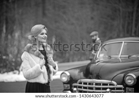 Retro photo of two traveler woman and man in retro car