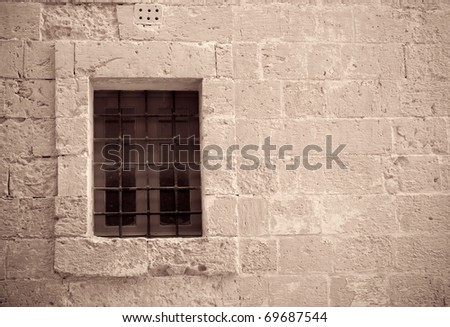 Retro photo of window with old lattice  in vintage wall