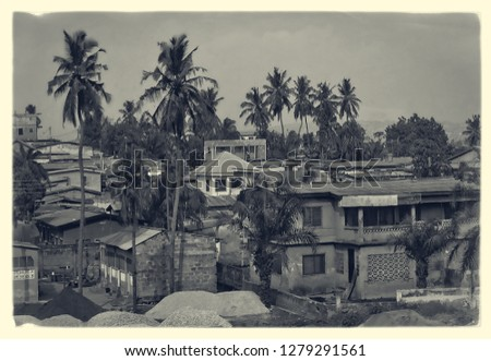 Retro photo. Vintage. African town. Matte background. Top view on residential district, densely located houses, yards and palm trees. Old postcard. Black and White Photography
