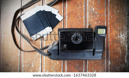 Retro Polaroid Camera and Polaroid Film on Old Wooden Table, Photography Creative, Polaroid Camera Concept, Top View, Empty Space For Text