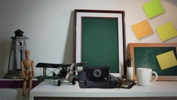 Retro Polaroid Camera With Photo Frame on Table, Decoration on Working Table