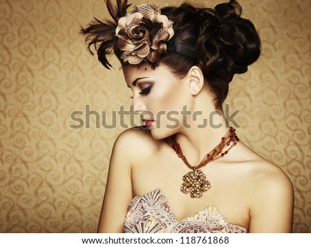 Retro portrait of a beautiful woman. Vintage style. Fashion photo