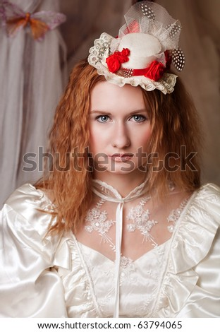 Retro portrait of a young girl in white lacy dress - stock photo